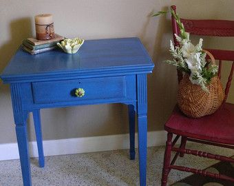 Small square vintage oak table painted with Annie Sloans Florence, lightly distressed and sealed with clear wax. This cute accent table would look great in a bathroom holding towels or anywhere for a splash of color.  Measurements:18 W x 18 D x 26 H  PLEASE READ MY SHIPPING AND REFUND POLICIES BEFORE YOU ORDER BECAUSE I WANT YOU TO BE TOTALLY HAPPY WITH YOUR REDEFINED PIECE MADE JUST FOR YOU. Once you place your order, please note there are no refunds or cancellations.  I try to ship…