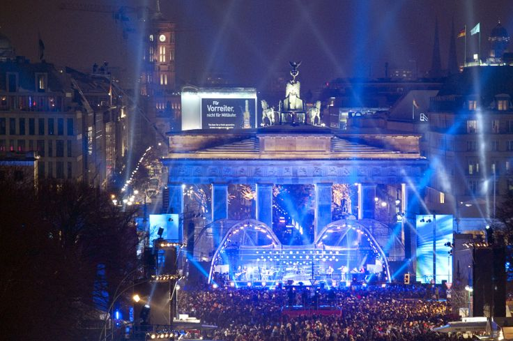 """More than one million people fill the """"Party Mile"""" in #Berlin, Germany on New Year's Eve, lined with music stages and food and drink tents serving beer, mulled wine, currywurst, and pork sausage."""