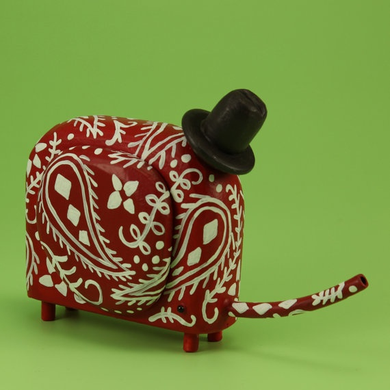 elephant figure by bunny with a tool belt!