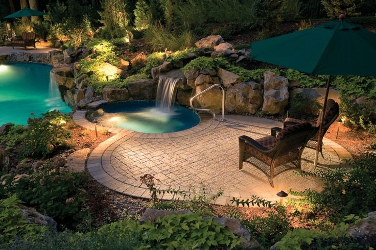 The outdoor living design around this pool includes 'outdoor rooms.'  One outdoor room is a situated around the hot tub and a second is at the far end with a comfy loveseat.  The outdoor living space is completed with landscape lighting and elegant landscaping.: Swimming Pools, Idea, Living Design, Swim Pools Decks, Outdoor Rooms, Landscape Lights, Outdoor Living Spaces, Hot Tubs, Swimming Pool Decks