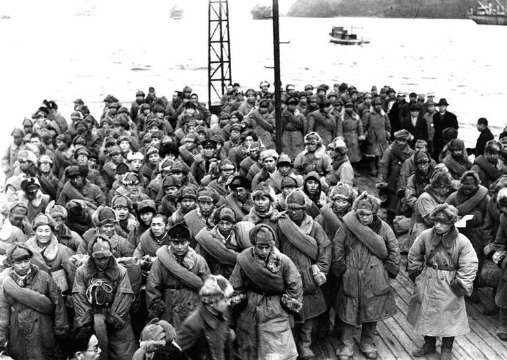 Japanese soldiers returning from Siberia, where they were imprisoned after World War II, wait to disembark from a ship at Maizuru, Kyoto Prefecture, Japan in 1946. By the end of World War II Japanese army consisted of half of military command units and volunteers and half of conscripted civilians, total amount to 6 million men. Soon after Potsdam Declaration and surrender of discretion the Quantun Army in Manchuria (North-East of China) was marooned by Soviet forces. Soundly defeated, all of