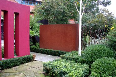 Mexican coloursBarrigan inspired garden with contemporary features. Pink walls, perennial planting, box hedging, tree ferns.  Design Catherine Heatherington