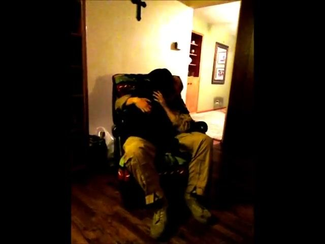 """""""Daddy's Home"""" surprise for dog after a long deployment.  It brings tears to your eyes."""
