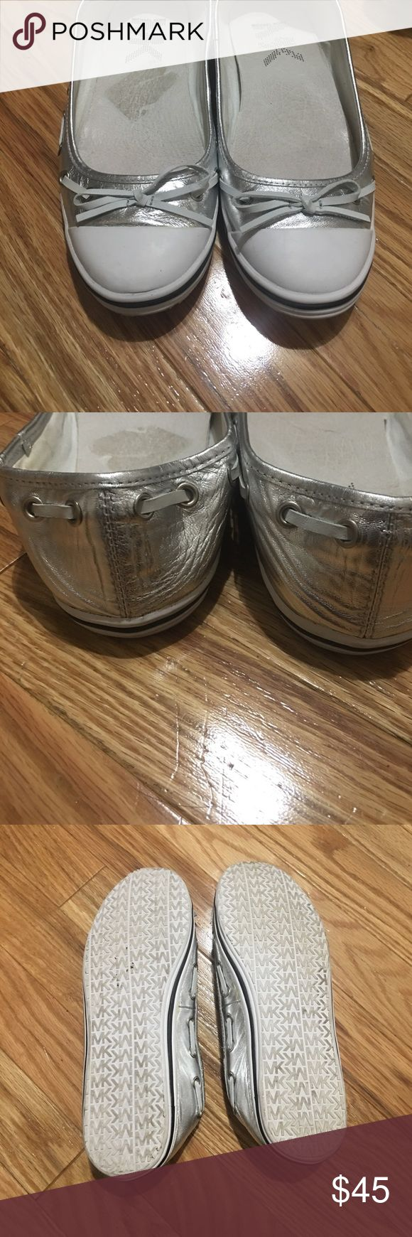 Micheal Kors slip ons Adorable silver and white Micheal Kors deck slip on shoes. White toes with silver body with white leather accent running around top. Cute and light weight perfect for spring/summer!! Michael Kors Shoes Flats & Loafers
