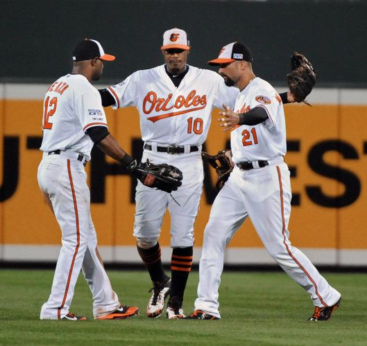 From left to right, Orioles outfielders Alejandro De Aza, Adam Jones and Nick Markakis celebrate after the team's 12-3 win over the Detroit Tigers in Game 1 of the American League Division Series at Camden Yards.