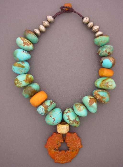 $3,475   Huge turquoise nuggets from the Kingman Mine in Arizona, antique Moroccan amber, a bead from Papua New Guinea, and Tuareg silver beads combine in this great necklace. The blue of Kingman turquoise became the color standard of the industry, highly collectable even before the mine was closed. Nuggets of this size and quality are incredibly difficult to find.