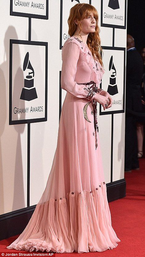 Out of this world: Florence + The Machine's Florence Welch showed off her quirky style in a pink Gucci gown with glittering star and moon motifs