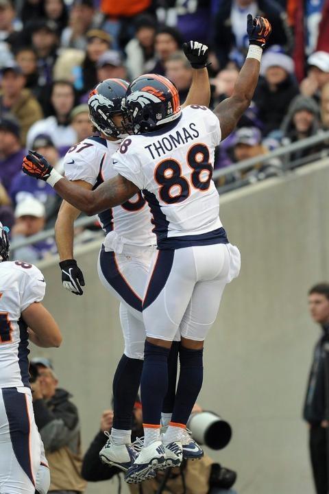 Decker celebrates the score with fellow wideout Demaryius Thomas. Broncos vs. Ravens 12-16-2012.