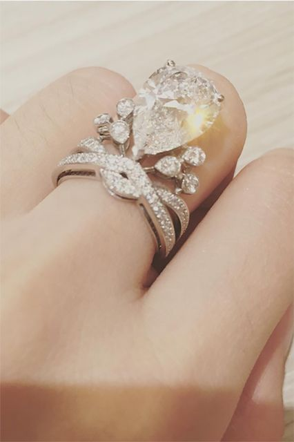 Angela's (a.k.a. Angelababy's) $1.5-million ring (made by Parisian designer Chaumet) boasts a five-carat, pear-shaped diamond surrounded by a bunch of other diamonds, because why not? #refinery29 http://www.refinery29.com/2015/11/97473/most-expensive-weddings-pictures#slide-3