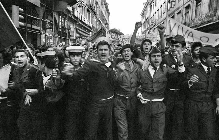 """1974 Carnation Revolution - Portuguese Navy sailors and Army soldiers of the left-wing revolutionary Armed Forces Movement (Movimento das Forças Armadas) demonstrating in support of the overthrow of the Fascist """"Estado Novo"""" regime."""