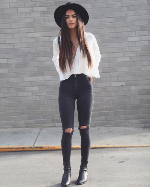lace up blouse, wide brim fedora, ripped black skinny jeans, and ankle boots.