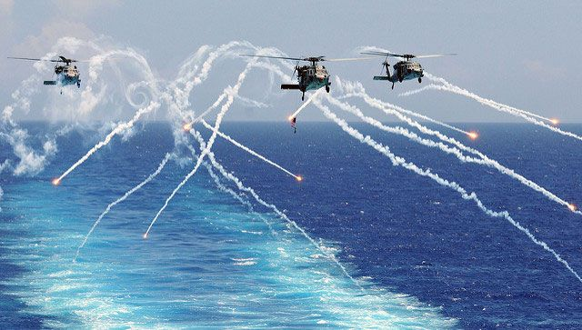 Naval Exercises Add Trillions of Pieces of Plastic Debris to Oceans  By Dahr Jamail, Truthout | Report  US Navy helicopters fire flares alongside an US aircraft carrier on August 2, 2012. (Photo: Mass Communication Specialist Seaman Zachary A. Anderson / US Navy)