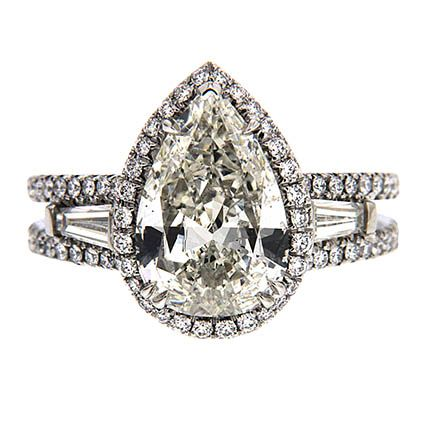 Pear Shape Diamond Engagement Ring VMEN-2-B Pear Shape diamond engagement ring in platinum with a halo, Tapered baguettes and round brilliant diamonds on the shanks.