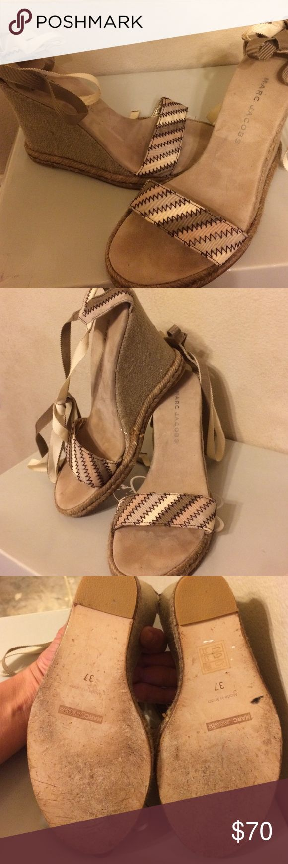 Marc Jacob wedge sandal org$300 Linen khaki and olive colored wedged heels sandal espadrille by Marc Jacobs cream and I'll live riven back by the heel wraps around the ankle and brings to a Thai stripes in plum olive khaki and cream heel covered in a burlap type material comfy gently worn 2x and cared for. Make OFFER PLEASE TAKING OFFERs WILL TRADE FOR MISS ME JEANS  27,28 W OR UGG BOOTS sz8 Marc Jacobs Shoes Ankle Boots & Booties