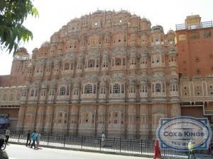 """On our way to the airport we stopped for a photo shoot at Hawa Mahal, the """"Palace of Winds"""", built in 1799 by Maharaja Sawai Pratap Singh, and designed by Lal Chand Ustad. The five-storey facade has been designed to look like the crown of Lord Krishna, and the honeycomb exterior has 953 windows with intricate latticework. #CoxandKings"""