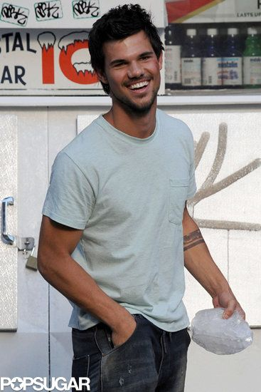 Smiles on Set | Taylor Lautner grinned between takes on the set of his new film Tracers.