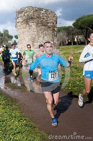 Man gesturing during Marathon of the Epiphany, Rome, Italy Man gesturing while running Marathon of the Epiphany in Parco Degliacquedotti, Rome, Italy. Photo taken on: January 06th, 2016