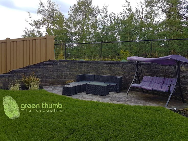 Valleystone Retaining Wall. A modern, clean cut wall to help maximize yard space.