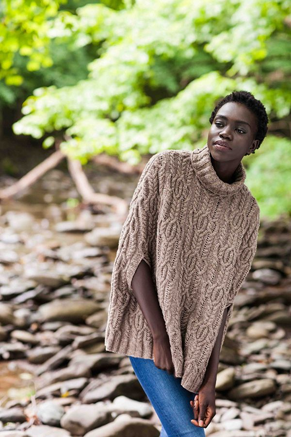 """I liked designing this poncho with a little more structure; the turtleneck, seamed sides and armhole openings will make certain this poncho doesn't twist around or become too fussy to wear. The allover cable and lace stitch motif make it quite the fun knit and a statement piece."" – Michele Wang"