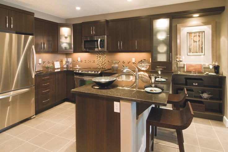 Kitchen By: Mattamy Homes Dark Cupboards, Light Floors. | In A