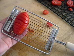 tip: use a gadget to make even slices for better dehydrating.  also info on making tomato powder and ratios for rehydrating