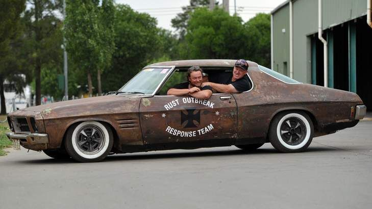 A very rusty HQ Holden Monaro arrives at scutineering with owners Darrin Davis, left, and Matt 'Red' Davis, from Orange.
