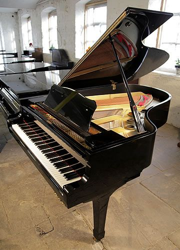 A 1975, Yamaha G5 grand piano for sale with a black case and spade legs. Piano hass eighty-eight notes and three pedals at Besbrode Pianos