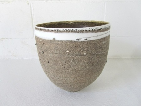 Megan Puls     Large vessel     Pierced mixed recycled clays with porcelain     24 x 23 cm