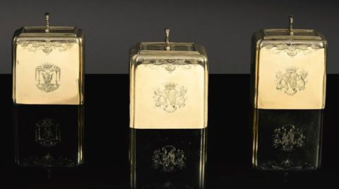 These superb silver-gilt tea caddies are our  Made ca. 1732 by the renowned Huguenot silversmith Paul de Lamerie, they belonged to Charles Spencer (1706-1758), later 3rd Duke of Marlborough. The lid of one caddy is engraved with the letter 'B' for black tea, while the other bears the letter 'G' for green tea. The central caddy, which was used for mixing the teas, is engraved with male and female profiles, possibly a reference to Charles Spencer's marriage to Elizabeth Trevor