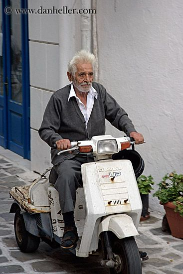 Old Greek man on scooter