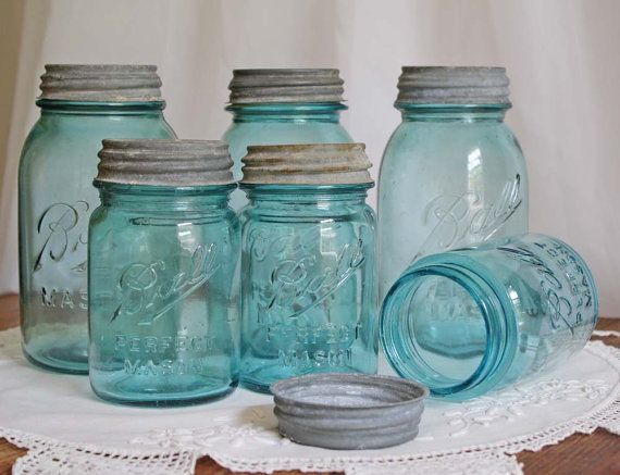 Old blue mason jars - I have a ton of these given to me by my Nanny (grandma) and that I've bought in antique stores over the years. I fill a few up every trip we take to the beach and then put a label around the top with the name of the beach and the date.