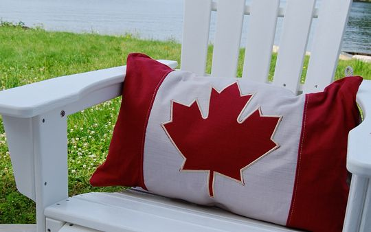 Canadian Flag Pillow relaxing in a Muskoka Chair