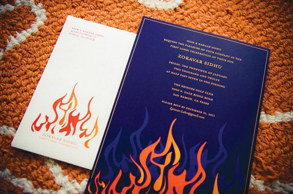 first birthday invitation with deep blue and orange flames