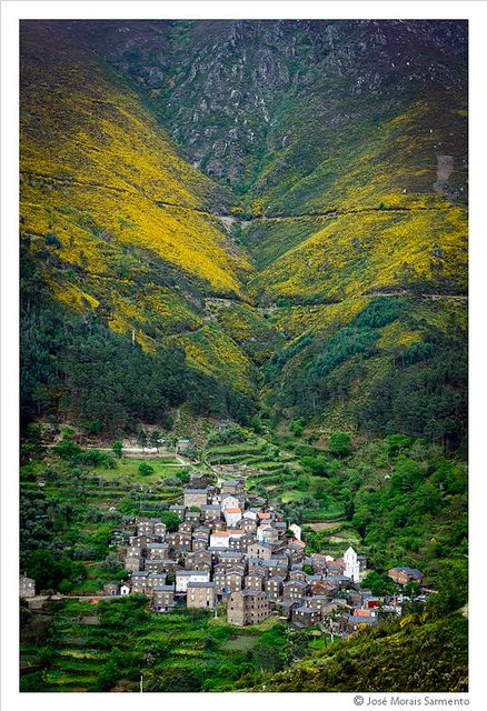 Piodão, Arganil, Portugal - The Piodão village, situated on a hillside of the Serra do Açor. The dwellings are traditional schist walls and ceiling covered with slabs and wood doors and windows painted in blue.