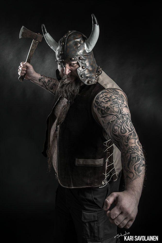 Photo by Kari Savolainen. Viking studio photoshoot, axe, helmet, horns, tattoo, sleeve.