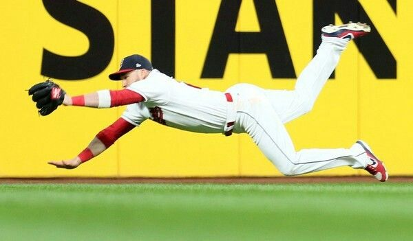 Cleveland Indians' Jason Kipnis  makes a diving catch for the out hit by New York Yankees' Chase Headley in the top of the 3rd inning, Thursday, October 5, 2017. (Chuck Crow / The Plain Dealer). Indians won 4-0 in game 1 of ALDS