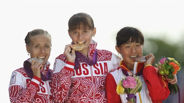 Gold medallist Elena Lashmanova of Russia, silver medalist Olga Kaniskina of Russia and bronze medalist Shenjie Qieyang of China attend the medal ceremony of the Women's 20km Walk on Day 15 of the London 2012 Olympic GamesOlympics Games, London 2012, 2012 Olympics, Russia, Medallist Elena, Olympics Photos, Olympics 2012, Elena Lashmanova, Gold Medallist