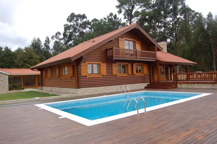 This classy wooden house by Rusticasa gets a refreshing upgrade by the modern pool.