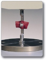 Slot Tear Rig: the slot tear test or Baumann Tear Test  measures the force to tear a slotted sample apart at a constant speed. While the Standard only requires the maximum force to be   measured, average tear force, force  maxima and minima and work done   can also be measured automatically.