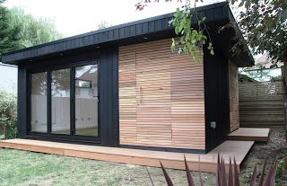 office in my garden: A Large Garden Room with contrasting Cedar Claddin...