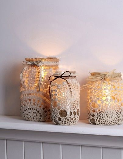 Great centerpiece option to create a candle lights ambiance and economical. Lace covered jar lights! wedding décor