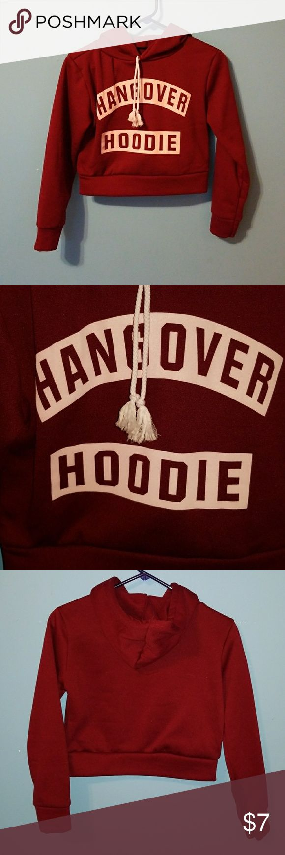 Crop Top Hoodie The hoodie is a burgundy/wine color. Soft like fleece on the inside. It is warm. Only worn once; I bought it and is too small to be truly comfortable. There is no tag with a size; however i usually wear a medium to large. Not sure of the original price. Tops Sweatshirts & Hoodies