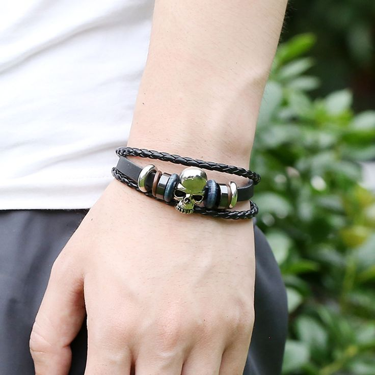 Skull charm leather bracelet for men and women.