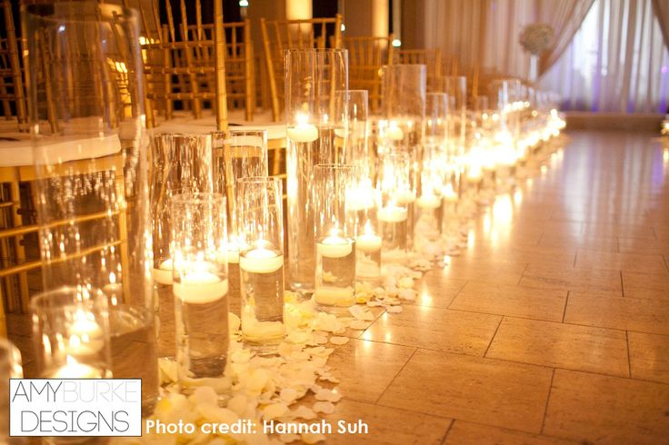 Close Up Of The Floating Candles Down The Wedding Aisle