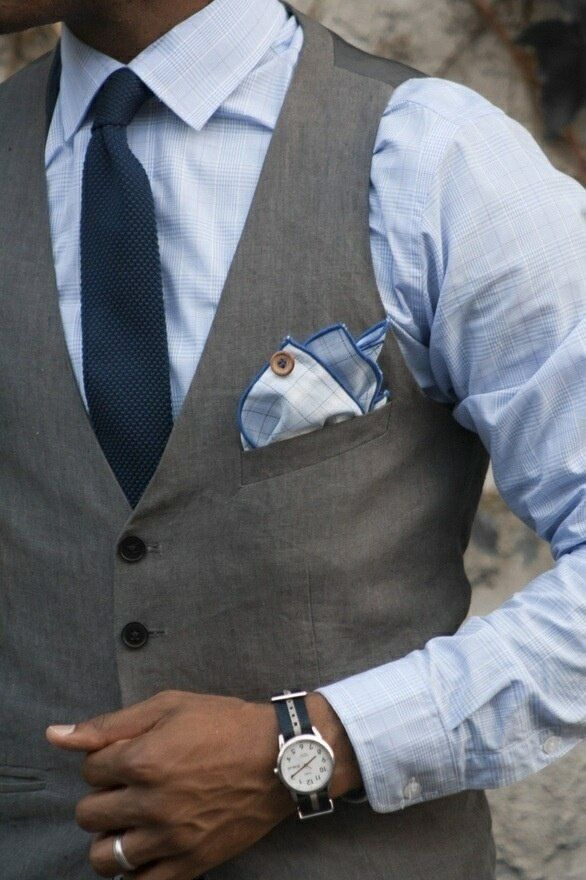 man's style fashion: grey vest, pale blue shirt, pocket square, navy blue tie