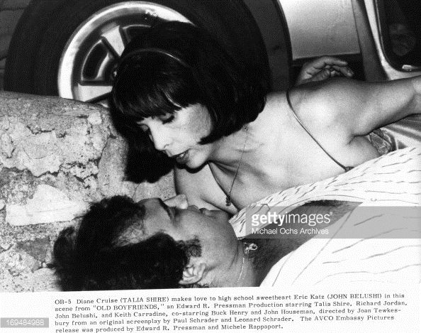 News Photo : John Belushi lies in bed with Talia Shire in a...