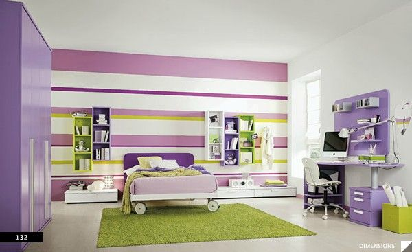 Love the colors used. A bed on wheels- fun idea. Wall design generates large results in girls bedroom