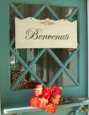 """'Benvenuti' means 'Welcome' in Italian! It's in the plural form and masculine as this is the genre to be used when addressing a group of people composed of both men and women. For example, you can use it in the phrase: 'Benvenuti a tutti!"""" meaning 'Welcome everybody!'"""