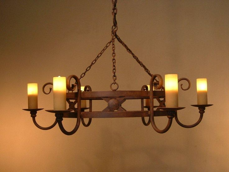 Custom made 'rustic' chandelier in the rust paint finish. Perfectly suited for a large patio entertainment area.