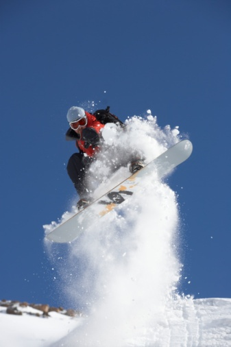 High-Res Stock Photography: Male snowboarder in air
